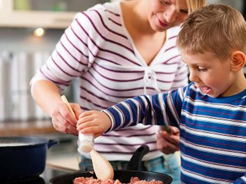 child and parent cooking
