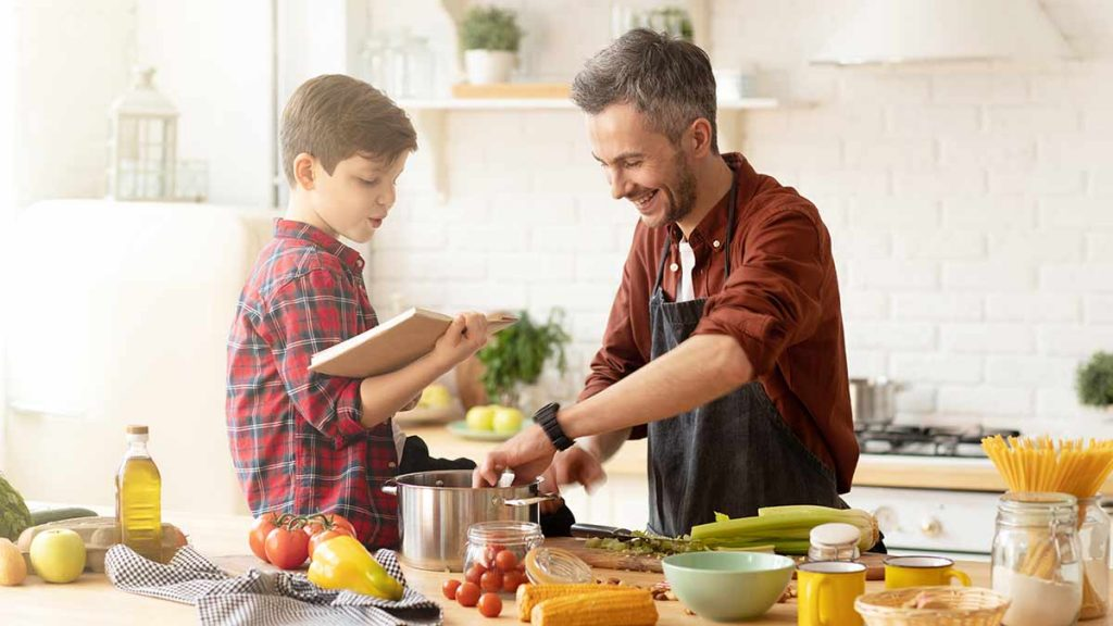 boy and dad cooking